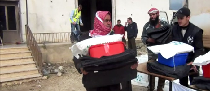 Syrian Man receives Irish Aid Emergency Pack at Goal distribution post in Northern Syria.