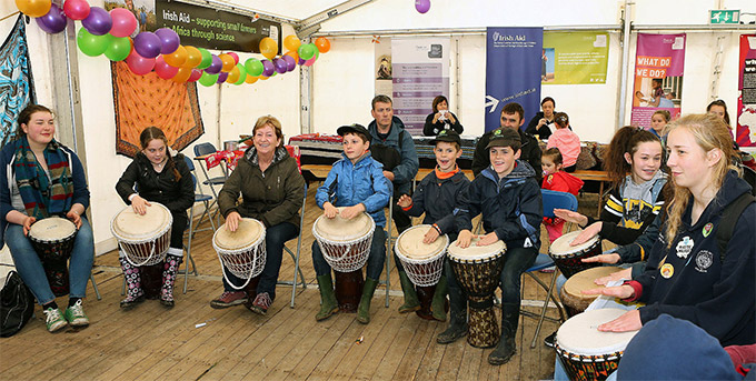 Children participating in an Irish Aid run drumming workshop at the 2015 National Ploughing Championships.