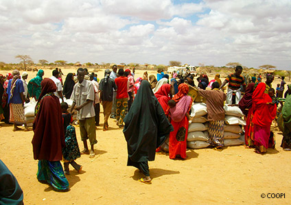 Local people affected by the Somali food crisis receiving supplies, Dollow, Somalia