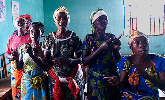 Members of the sexual violence survivor support group SARCAF sing on a Sunday morning in the village of Walungu, South Kivu, on the DRC/Rwandan border. Photo by Will Storr