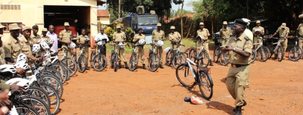 Regional Liaison Officer George Kalamu speaks to trainees in Uganda at a police training session.