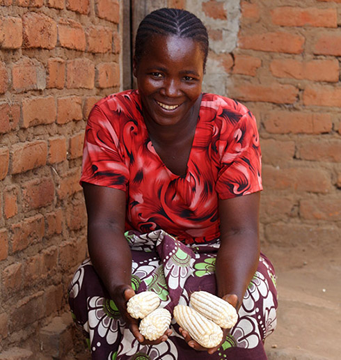Doris Hassan, a member of Wawakuda co-op in Tanzania with some of her corn crop