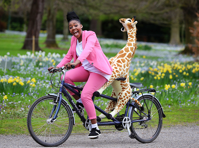 Africa Day champion Onai Tafuma with Gemma the Giraffe